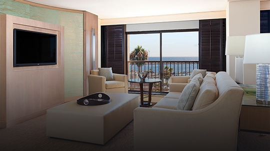 Interior image of a Livingroom with the ocean visible out the window